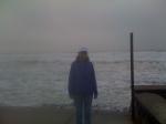 Morning walk post-marathon along an angry ocean