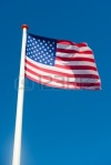 8580479-u-s-american-flag-in-front-of-a-blue-sky