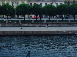 Midnight runner during St. Petersburg's white nights.